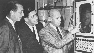 Prolific author and head of cardiovascular research Aldo Luisada, MD (at right), illustrates a piece of equipment in his laboratory during a tour of the Chicago Medical School Institute in 1963.