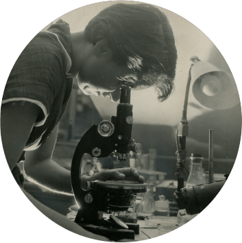 Rosalind Franklin at a Microscope